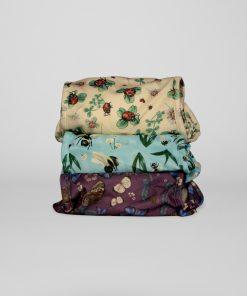 Tre PUL-skal från Little Lamb nappies, mönster med humlor, nyckelpigor och fjärilr